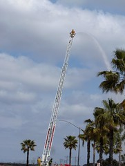 Fireman watering palm trees (Kevin Schwinkendorf) Tags: tree water palms drops san diego spray palm hose falling palmtrees fireman fireengine firemen firefighters robusta washingtonia mexicanfanpalms