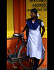 Waiting (Rick Elkins) Tags: blue orange woman india color girl bicycle sign yellow wall standing bravo waiting searchthebest candid streetphotography type tamilnadu pondicherry firstquality fpg mywinners puducherry platinumphoto anawesomeshot goldenphotographer rickelkins