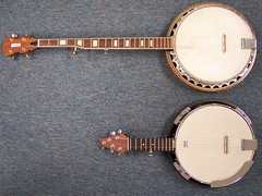 Comparing J.R.'s sawed-off banjo to a standard 5-string banjo.