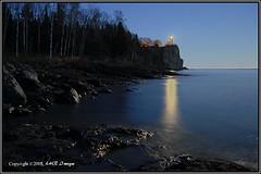 Split Rock Lighthouse in the Moonlight (ns0811-01-084) (nibi mocs) Tags: blue lighthouse lake minnesota night glow shoreline northshore moonlight lakesuperior soe hdr blueribbonwinner splitrocklighthouse nikond200 auclairdelalune colorphotoaward vosplusbellesphotos exphoto