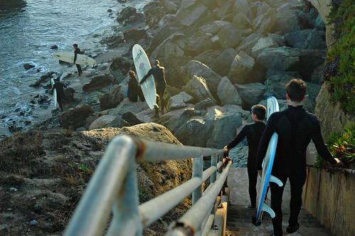 california winter boy usa santacruz sun sunlight men beach wet water stairs walking rocks surf day action father surfing learning surfers fatherandson activity wetsuit wetsuits suited wonderlane 7413 withsurfboards enteringthewaterwinter