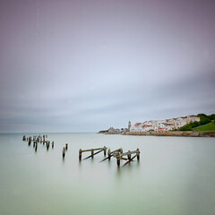 (Claire Hutton) Tags: old uk longexposure sea england bw seagulls motion water rain clouds square pier wooden smooth overcast dorset format posts raining swanage remains buoy silky ndfilter 10stop nd1000 nd110 bw110 leefilters 03nd 09ndgrad