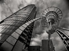 the odd couple (mugley) Tags: sky blackandwhite bw sculpture abstract building tower 120 film architecture clouds contrast rollei corner mediumformat 645 stainlesssteel apartments grain australia melbourne wideangle victoria aurora epson docklands publicart polarizer 6x45 residential r3 imposing mamiya645 urbanlandscape redfilter bourkest polariser 25a v700 victoriapoint mamiya645protl m645 rolleir3 harbouresplanade geoffreybartlett 35mmf35sekorn