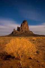 Agathla (Tyler Westcott) Tags: longexposure arizona southwest night clouds stars explore navajo elcapitan shrubbery coloradoplateau agathla nikond40 klsouthwest2008