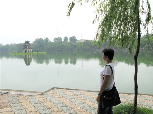me gazing at Hoan Kiem Lake, Hanoi