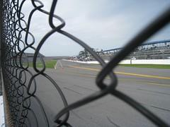 fenced off (sun dazed) Tags: racetrack fence dof florida chainlink nascar daytona daytonainternationalspeedway pitroad