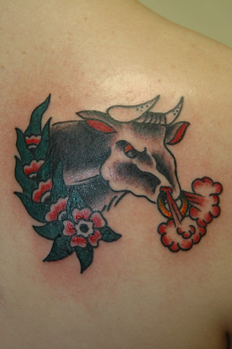 Bull tattoos are designed as an action piece. Some of the action pieces of