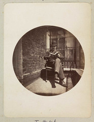 Seated man reading a book