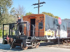 Caboose conductor giving radio orders for the locomotive crew to proceed. Melrose Park Illinois. October 2007.