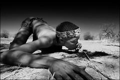 bushman perspective (Alessandro Vannucci) Tags: africa people bw face relax san cigarette smoke forsakenpeople bn hunter tribe namibia ritratto hunt portrair bushman boscimani nhoma kaudom bushmanland iannacell khaudom
