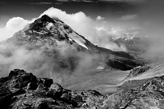 Illiniza Sur in bw  Ecuador (Ole Begemann) Tags: 2005 travel schnee sky bw mist snow postprocessed mountains latinamerica southamerica nature water monochrome fog clouds landscapes blackwhite ecuador reisen wasser nebel natur lakes himmel wolken berge valley andes sw volcanoes seen tal landschaften anden nachbearbeitet lateinamerika sdamerika vulkane illiniza schwarzweis pichinchaprovince illinizanorte illinizasur camera:iso=100 camera:model=canoneos20d lens:aperture=f11 camera:shutter=sec provinciadepichincha lens:focallength=12mm original:filename=2005110620d005796