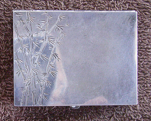 Hand Engraving on a silver box.