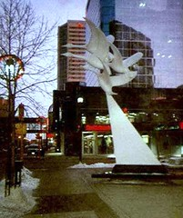 94326_21 Geese Sculpture, Regina SK 1997 (CanadaGood) Tags: sunset sculpture canada color colour building art analog evening geese slidefilm 1997 streetphoto sk regina saskatchewan nineties seattlefilmworks canadagood sfwdigital