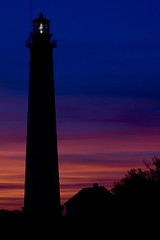 Ft Story VA Lighthouse (RMac_Photography) Tags: ocean blue sunset sea orange lighthouse beach silhouette wow d50 coast virginia nikon va stunning virginiabeach rmac ftstory