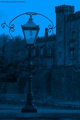 BLUE LIGHT (michaeljohnsimages) Tags: camera bridge blue ireland light black colour building castle art classic lamp canon landscape photo flickr view bricks snapshot picture entrance explore journey observe