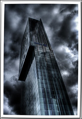 the f***in' tower HDR (...the truth is hidden...) Tags: camera uk england sky west building slr tower glass clouds digital canon lens manchester eos 350d rebel xt reflex high kiss raw moody dynamic image united north kingdom lancashire photograph single fin range seriously hdr novideo beetham photomatix geometrictonalvision clevercreativecaptures