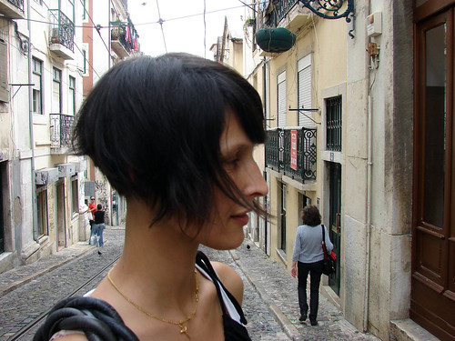 Short in the back, long in the front. Very cut with layers and bangs.