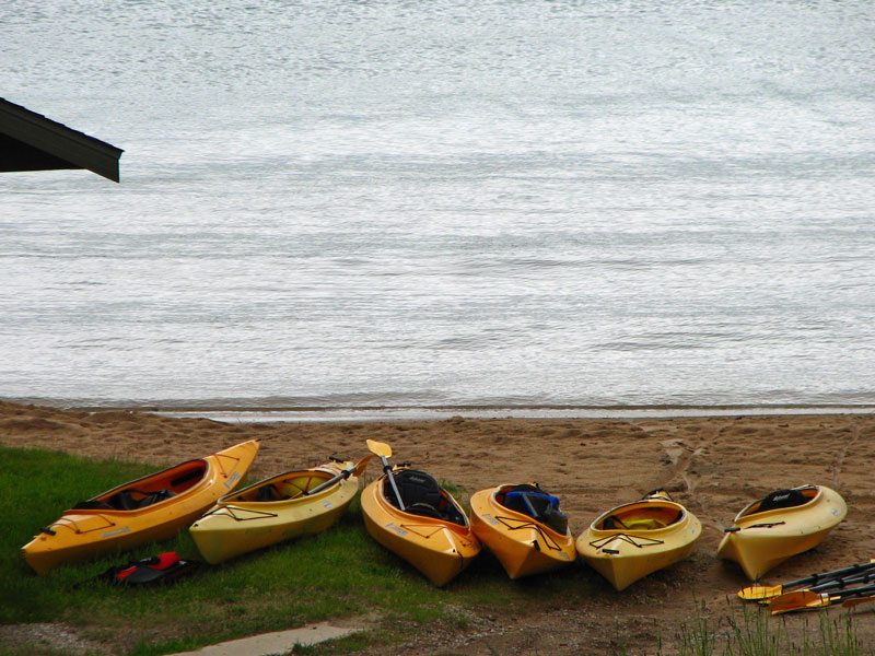 Kayaks on the shore of Lake Walloon