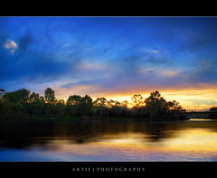 Almost a silhouette but not quite yet - HDR (:: Artie | Photography :: Happy 2016 !) Tags: trees sunset sky colour reflection nature water photoshop canon river colours cs2 tripod kitlens australia adelaide ripples 1855mm southaustralia efs hdr artie 3xp photomatix tonemapping tonemap 400d rebelxti guasdivinas