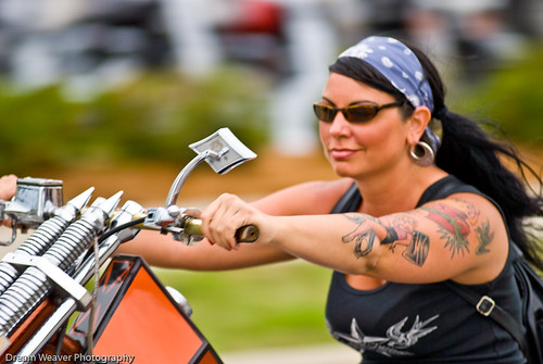 "Biker babe on a chopper she entered in the Willie's Tropical Tattoo ""old"