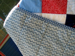 backside and binding of red blue patchwork quilt