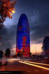 Torre Agbar by night (arturii!) Tags: barcelona road street city blue sunset sky building cars water colors skyline night clouds speed wow lights 22 amazing interesting movement arquitectura europa europe colours view action capital cel catalonia fave exposition coche stunning vista metropolis torpedo perspectiva vermell catalunya blau typical hdr carrer torreagbar artur aigua catalua urba barcelone nit cotxes ciutat treatment llums nuvols edifici poblenou urbe pepino jeannouvel andscape catalogne exposici eixample barcelons falico capvespre blaugrana photomatix impresive horitz canoneos400d supositori arturii