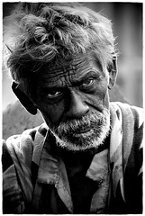 not-so-pleased (Soumya Bandyopadhyay) Tags: street look eyes beggar angry kolkata annoyed tamron28300mm pentaxk100d aplusphoto