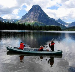 Canoeing by Sinopah Mountain, Glacier NP , Montana's Best (moonjazz) Tags: family red wild mountain lake reflection green nature water beauty clouds forest wonder relax landscape fun rockies amazing perfect montana peace slow view natural paddle tourist canoe safety glacier adventure together enjoy zen rest vest glaciernationalpark wilderness pure splendor sinopah mywinners flickrlovers twomedicenlake