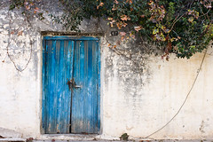 Blue door (macropoulos) Tags: door blue 500v20f decay urbandecay greece 500v50f crete canonef35mmf2 1000v100f topf100 bluedoor heraklion 1500v60f 1000v40f flickrsbest golddragon abigfave canoneos400d anawesomeshot 100faves100comments1000views infinestyle ysplix betterthangood gettyimagesgreece1