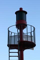Pier Head light 1 (jurassic john) Tags: winter light coast pier cornwall cage ladder westcountry onblue eos400d
