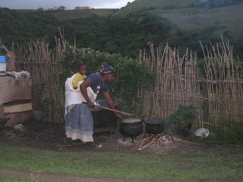 A Xhosa woman prepares our dinner