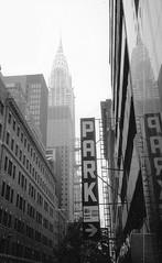 Chrysler building #1 (kcorrick) Tags: street city nyc blackandwhite bw newyork reflection architecture america skyscraper buildings us skyscrapers cityscapes scan chrysler chryslerbuilding manhatten