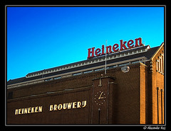 (48) Heineken Brewery (Amsterdam, Holland, The Netherlands) (Berlinalex) Tags: street travel blue red sky orange brown holland color building brick clock tourism netherlands beer amsterdam silhouette sign architecture advertising heineken geotagged gold heaven turquoise postcard landmark f30 brewery product brand brouwerij