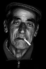 (ARTeTT) Tags: portrait people blackandwhite bw man black face hat cigarette bn blackground ritratto biancoenero blancinegre clairobscur blancetnoir darknesslight nobackground canonef70200f28isusm miraclesofsunlightinadarkstore