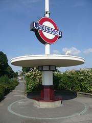 Oakwood Underground Station (Richard and Gill) Tags: london station sign underground logo metro seat tube rail artdeco londonunderground mast oakwood shelter piccadillyline roundel londontransport tfl transportforlondon charlesholden lightmast