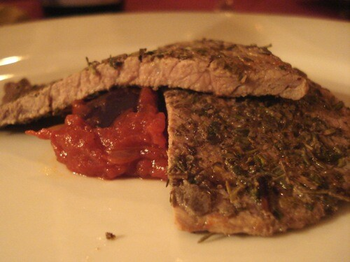 Herbed veal with spicy tomato and olive salsa