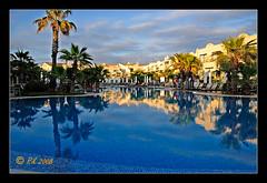 Evening light (rikl64) Tags: sky holiday reflection pool geotagged d70 complex menorca calaenbosch geo:lat=39929032 geo:lon=3835119