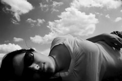 Year Of The Clouds (peterkelly) Tags: sky bw woman ontario canada film sunglasses clouds guelph canadian northamerica resting lying 2008 hillsidefestival blackwhiteaward expressofpro