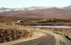what in the world ever became of sweet Jane (eyebex) Tags: autumn red mountains fall colors yellow delete10 landscape semi yukon transportation save6 trucking haul dempsterhighway 610 roadtoresources