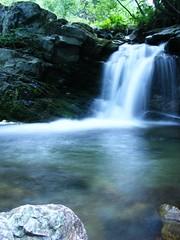 flowing... (endless.daydream) Tags: color colour water flow waterfall rocks fuji falling fujifilm flowing
