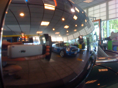 Reflection in the cover of a mirror on a MINI Cooper S at MINI of Annapolis - Taken With An iPhone