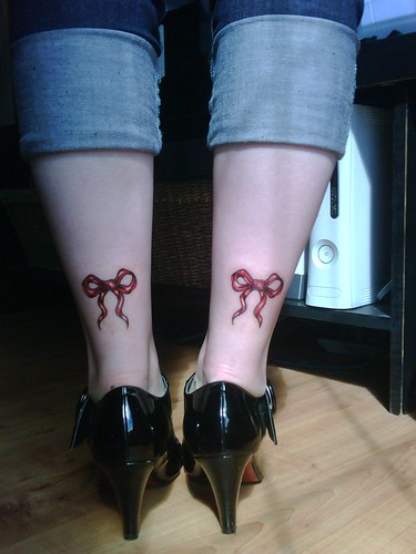 ribbon bow tattoo. ow tattoos