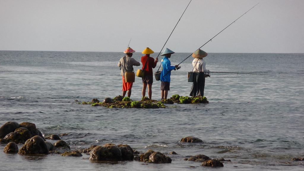 ['Bali.', ' fisherman at Uluwatu']