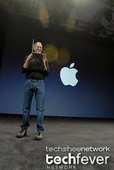 Apple CEO Steve Jobs showing the new Apple Mac...