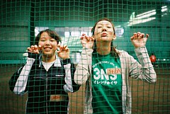 the stars of track and field (librarymook) Tags: camera girls green net film smile japan fun japanese fuji bokeh indoor natura iso 1600  fujifilm gym classica mooprint