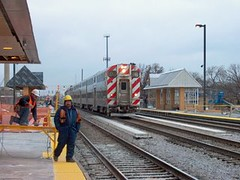 Clear the track men! Eastbound Metra express commuter train passing through the Grand / Cicero commuter station under construction.Chicago Illinois. December 2006.