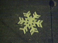 Snowflake on sidewalk