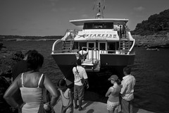 Boarding the Boat of Your Dreams and Memories (Gilderic Photography) Tags: trip travel sea summer vacation sky people blackandwhite bw woman sun mer white man black hot water girl monochrome creek island lumix grey mono islands soleil boat back spain europe barca raw ship child board ile tourist panasonic espana memory catamaran bateau mallorca isle espagne chaud boarding cala excursion ete majorca baleares lightroom mediterranea navire mediterranee crique majorque lx3 dmclx3