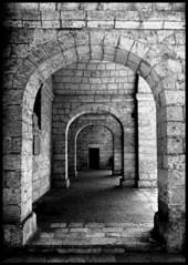 Stone Arches (albireo 2006) Tags: blackandwhite bw stone lumix mediterranean arch arcade masonry malta symmetry vault cloister archway portico mellieha blackandwhitephotos blackwhitephotos diamondclassphotographer flickrdiamond
