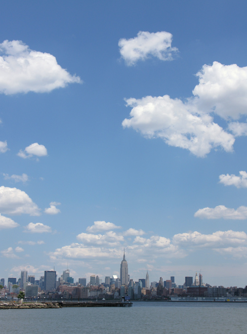 big clouds over the Empire State Building, seen from the Hudson River